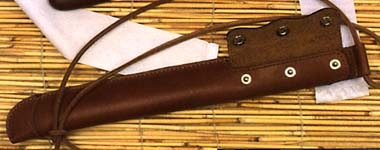 "Enshrined in Japanese history as a badge of honor, one of these aikuchi style dirks was presented to each WWII Kamikaze pilot before his last fateful mission. Encased in polished rosewood, the aikuchi style dirk features hand-forged edge-tempered blade with the ""Must Win"" motto of the Kamikaze Divine Wind inscribed in Japanese characters on the habaki."